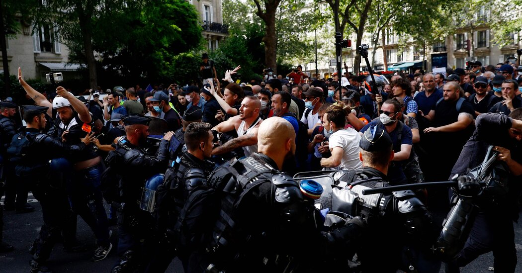 protesters-clash-with-riot-police-over-french-health-passes