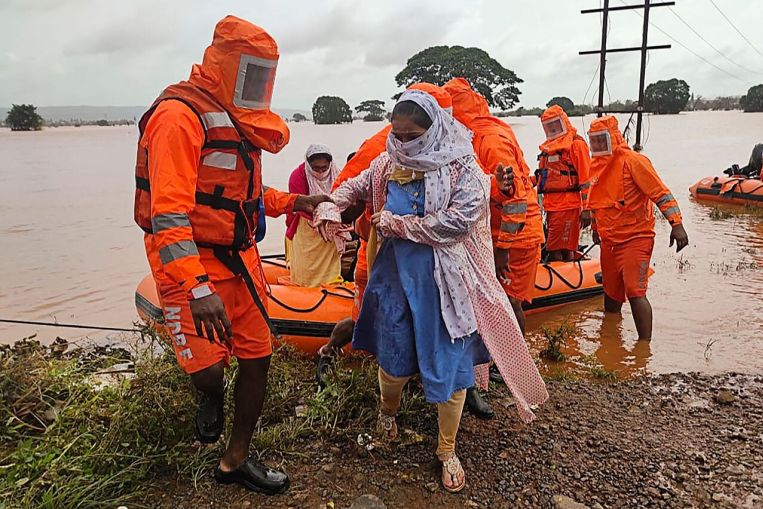 india-monsoon-death-toll-climbs-to-124-as-rescuers-search-for-missing