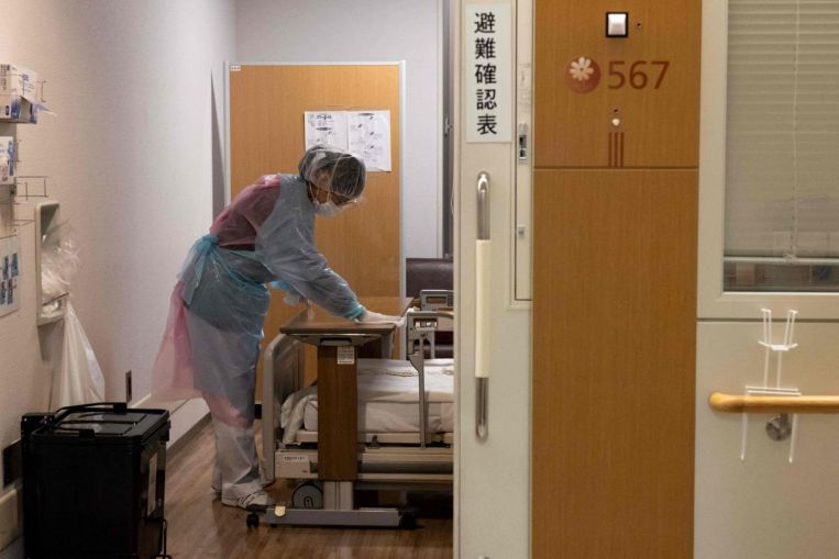 japan-limits-hospitalisation-of-covid-19-patients-to-most-serious-as-cases-surge